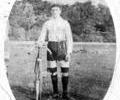 Young man in shorts with a bicycle