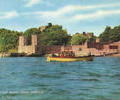 Yellow boat in front of Brownsea Castle