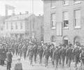 Procession of soldiers along Poole Quay