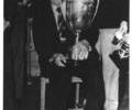 Unidentified man with trophy